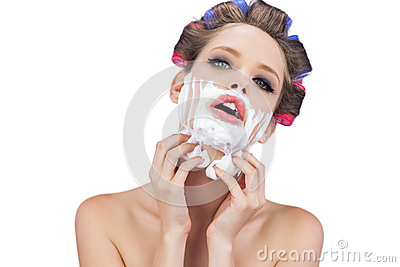 Sensual model with shaving foam looking at camera