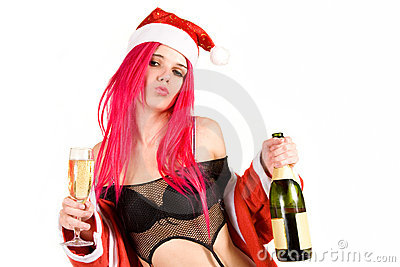 Sensual mrs. Santa with champagne glass and bottle