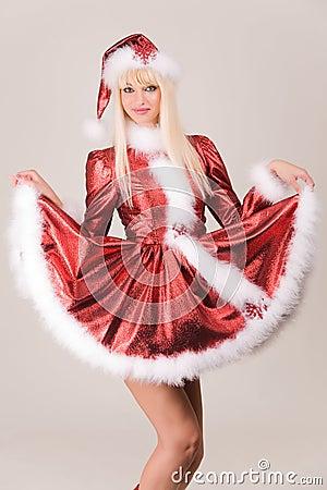 Sensual mrs. Santa in red dress