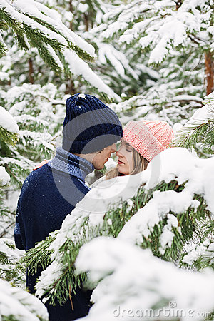 Free Sensual Pretty Couple In Winter Forest Among Fir Trees Royalty Free Stock Photo - 66287885