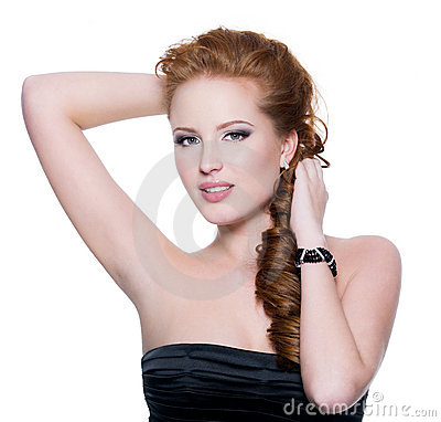 Sensual red-haired woman with glamour make-up