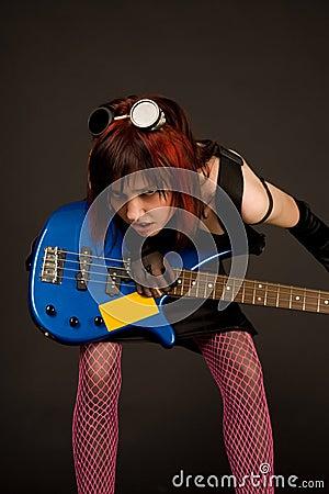 Free Sensual Rock Girl With Bass Guitar Royalty Free Stock Photo - 5551695