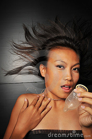 Sensual Seductive Asian Female with Contraceptive