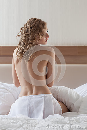 Sensual topless model posing back to camera