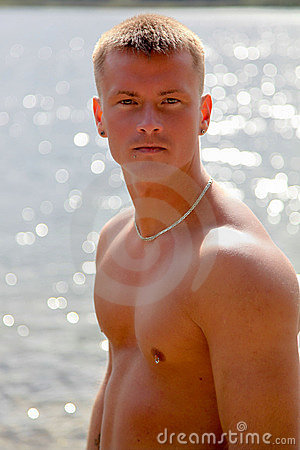 Sensual Topless Young Man On Waterside