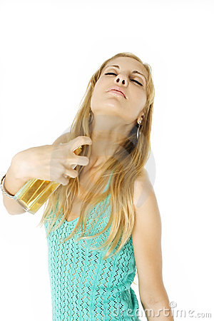 Sensual woman applying perfume on her body