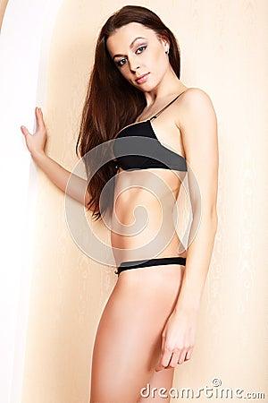 Sensual woman in the black bikini.