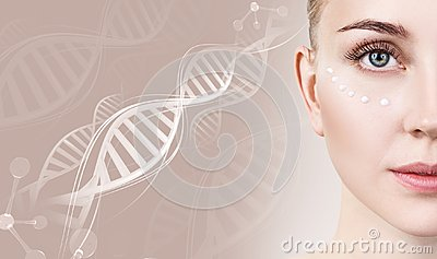 Sensual woman with cream dots on face in DNA chains. Stock Photo