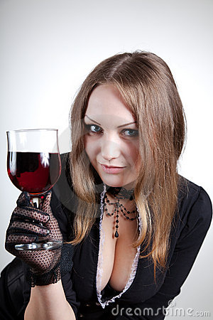 Sensual woman with glass of wine