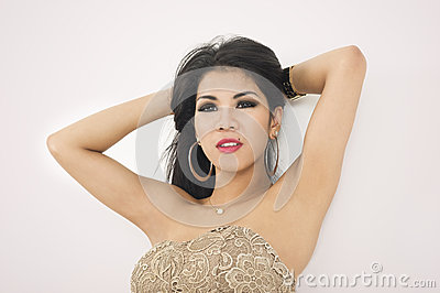 Sensual woman with her arms raised