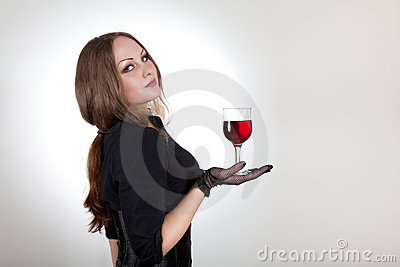 Sensual woman holding glass of wine