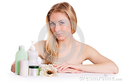 Sensual woman with skincare products