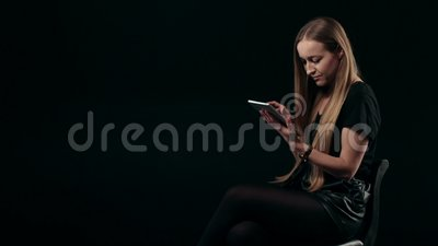 Sensual woman typing on digital tablet and smiling stock video footage