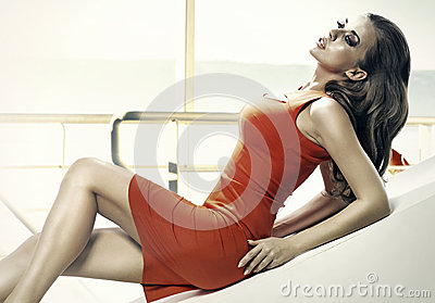 Sensual woman wearing red dress