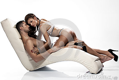 Sensual woman with sexy lingerie touching her husband