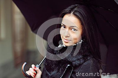Sensual young girl portrait with umbrella in a rainy weather