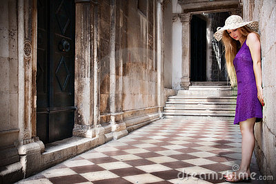 Sensual young woman and ancient building