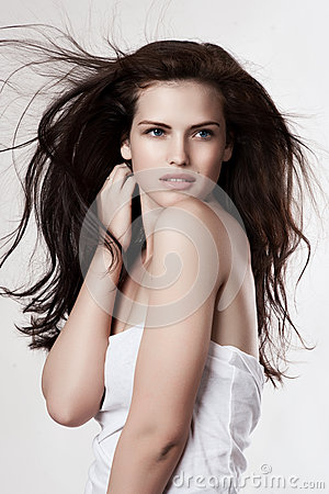 Sensual young woman with flying hairs