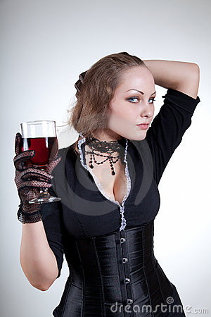 Sensual young woman with red wine