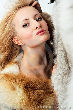 Sensuality attractive girl with foxy fur jacket