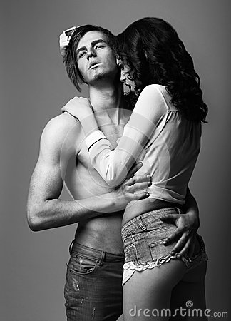 Sensuality. Love. Young Man and Woman in Cuddle