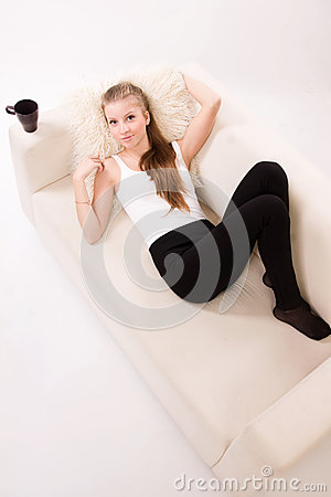 Sensuality woman lying on a sofa