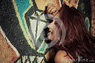 Sensuality.Women on graffiti background. Girl against painted wa