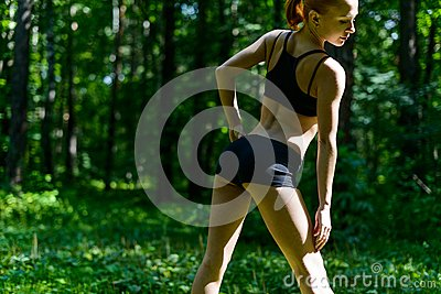Sensuous fitness woman in park