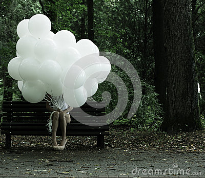 Sentimentality. Nostalgia. Lonely Woman with Air Balloons sitting on Bench in the Park