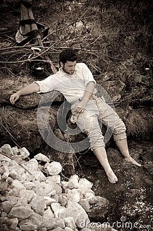 Sepia civil war confederate soldier near a creek Editorial Stock Photo