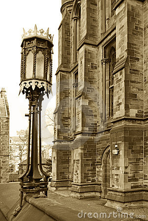 Sepia lamp and gothic building