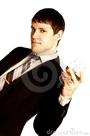 Sepia picture of a business man with a cognac glass