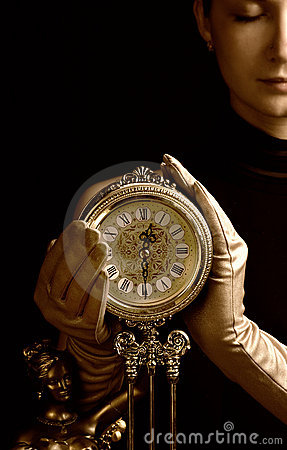 Free Sepia Picture Of A Beutiful Girl With A Clock (focus On Clock) Stock Photography - 2113922