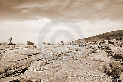 Sepia rocks in hilly rocky burren landscape