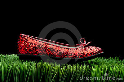Sequined red slipper on grass