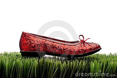 Sequined red slipper on  white