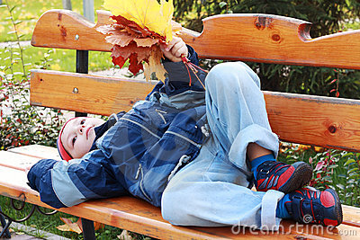 Serene boy laying on bench