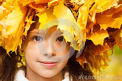 Serene girl with an autumn headwreath