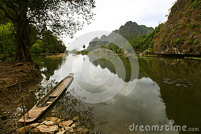 Serene lake scenery with a wooden fisherman s boat
