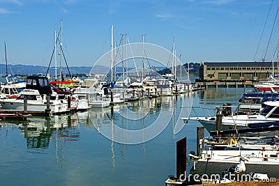 Serene Water Between Docked Boats Editorial Image