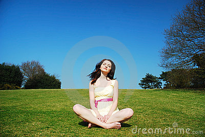 Serene woman in field