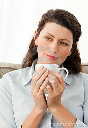 Serene woman holding a cup of coffee