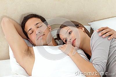 Serene woman lying on her boyfriend s arms
