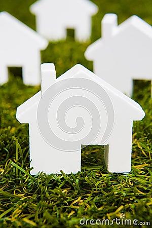 Series Of White Model House Arranged On Grass