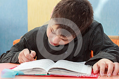 Serios boy doing lessons