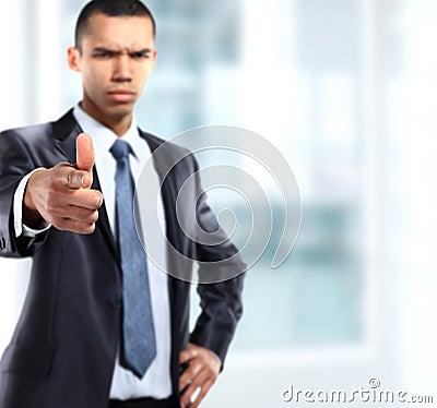Serios business man showing finger