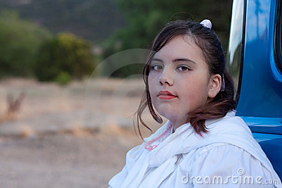 Serious 1950s teen girl in pickup truck