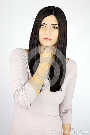 Serious beautiful woman sick with throat problem
