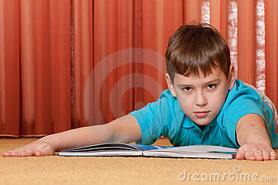 Serious boy with a book