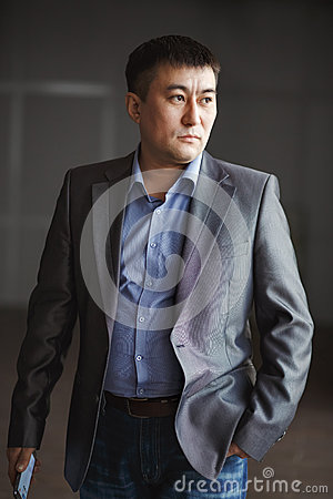 Free Serious Brutal Asian Business Man With Phone In Royalty Free Stock Photo - 65368805